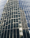 The Netherlands, Amsterdam, Office buildings reflecting in glass facade of modern apartments, - HAWF000229