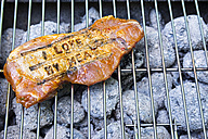 Pork steak with branding on barbecue grill - ONF000593