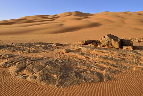 Africa, Algeria, Sahara, Tassili N'Ajjer National Park, Tadrart, Rocks and sand dunes at Oued In Djerane - ES001179