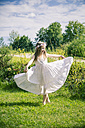 Girl in white summer dress on meadow - SARF000669