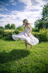 Girl in white summer dress on meadow - SARF000682