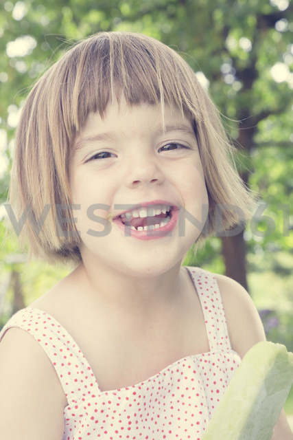 Portrait of laughing little girl with ice lolly - LVF001372