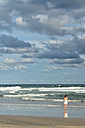 Australia, New South Wales, Pottsville, woman standing at the ocean - SHF001379