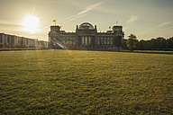 Germany, Berlin, Berlin-Tiergarten, Reichstag building against the sun in the morning - ZMF000291