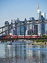 Germany, Hesse, Frankfurt, Deutschherrn Bridge with regional train, Financial district in the background - AM002284