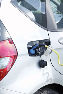 Electric vehicle is being charged - BSC000430