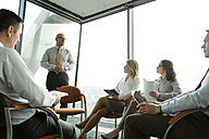 Group of businesspeople attending a seminar - WESTF019336