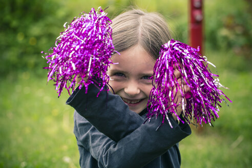 Portrait of happy little girl playing with decoration material - SARF000688