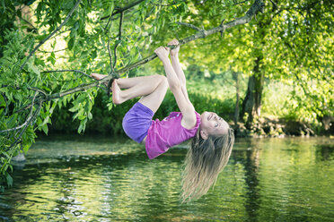 Little girl climbing on branch - SARF000699