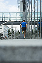 Germany, Baden-Wuerttemberg, Mannheim, mature jogger running in the city - UUF000854