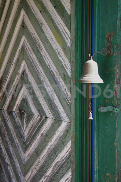 Wooden door with an old doorbell, partial view - AXF000695