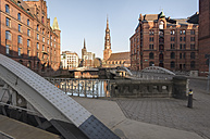 Germany, Hamburg, Speicherstadt in the morning, in the background St. Catherine's Church - RJF000180