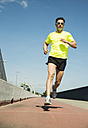Man jogging on bridge - UUF000934