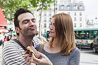 France, Paris, portrait of happy couple having fun - FMKF001251