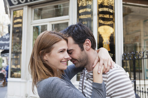 France, Paris, couple in love in front of pastry shop - FMKF001255