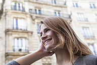 France, Paris, portrait of smiling young woman - FMKF001258