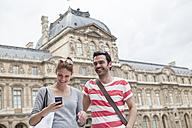France, Paris, portrait of happy couple having fun - FMKF001331
