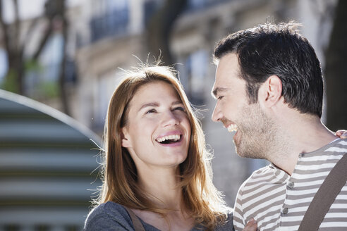 France, Paris, portrait of happy couple having fun - FMKF001344