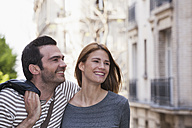 France, Paris, portrait of happy couple having fun - FMKF001347