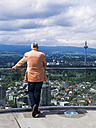 Germany, Hesse, Frankfurt, woman looking at view from panorama terrace - AM002392