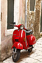 Greece, Ionic Islands, Corfu, Greece, Ionic Islands, Corfu, red old Vespa scooter parking in front of house - AJ000055