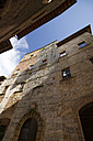 Italy, Tuscany, San Gimignano, Row of houses - MYF000370