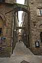 Italy, Tuscany, Volterra, Houses and alley - MY000394