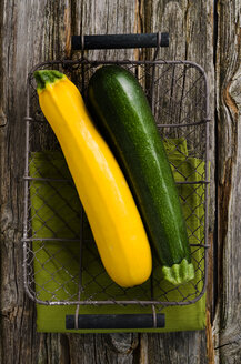 Green and yellow courgettes in a basket - ODF000725