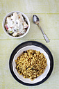 Bowl of pilaf and a bowl of raita and a spoon on wood, elevated view - EVGF000702