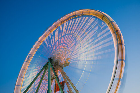 Germany, North Rhine-Westphalia, Cologne, part of lighted turning big wheel at blue hour - WGF000321