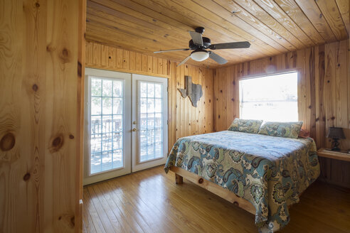 USA, Texas, Bed Room in Log Home Cabin - ABAF001360