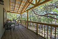 USA, Texas, Porch of log home cabin - ABAF001368