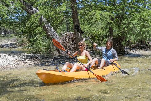 USA, Texas, Couple kayaking down the Frio River - ABAF001417