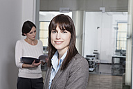 Germany, Munich,  Businesspeople in office - RBYF000541