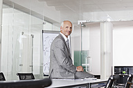 Germany, Munich, Businessman in conference room - RBYF000596
