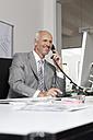 Germany, Munich, Businessman in office - RBYF000599