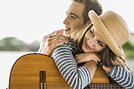 Portrait of young couple with guitar - UUF001052