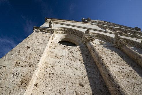 Italy, Tuscany, Massa Marittima, Massa Marittima Cathedral, Facade, Extreme low angle view - MYF000424