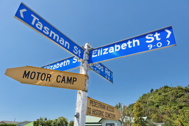 New Zealand, Golden Bay, Collingwood, fingerposts in the town center - SHF001470