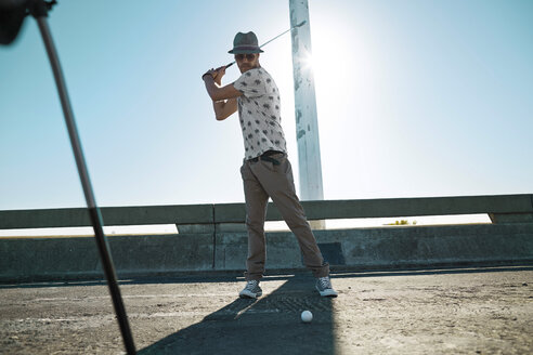 Man playing urban golf on street - VVF000150