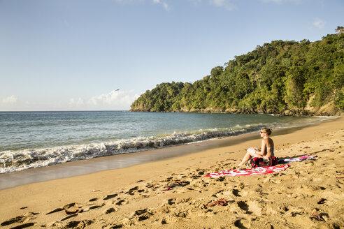 Caribbean, Trinidad and Tobago, Tobago, woman at Englishman's Bay beach - SKF001550