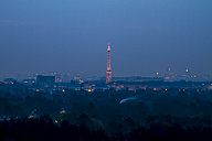 Germany, Berlin, View from Teufelsberg to Charlottenburg with Berlin radio tower in the evening - BIG000001