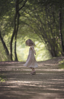 Little girl dancing on forest track - MW000051