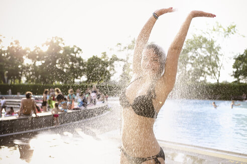 Young woman taking a shower in open-air bath - FX000030