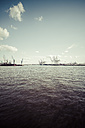 Germany, Hamurg, ship and cranes at container terminal Tollerort - KRPF000617