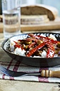 Sweet and sour eggplant with red Pepper on rice and garnished with sesame seeds - HAWF000338