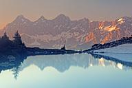 Austria, Styria, Liezen District, Tauern, View to Dachstein, Lake Spiegelsee in the evening - GFF000527
