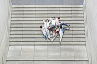 Group of students lying on stairs - WESTF019589