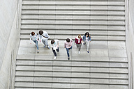 Group of students walking on stairs - WESTF019701