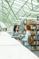 Two students in a university library - WESTF019730